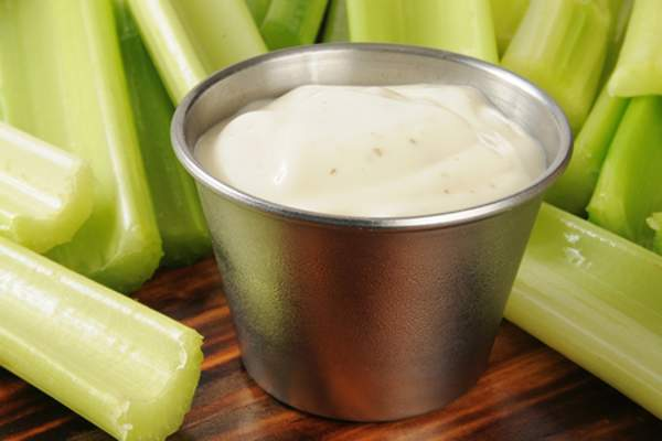 Celery with ranch dressing image.