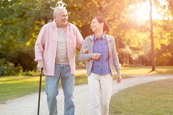 Caregiver walking with senior.