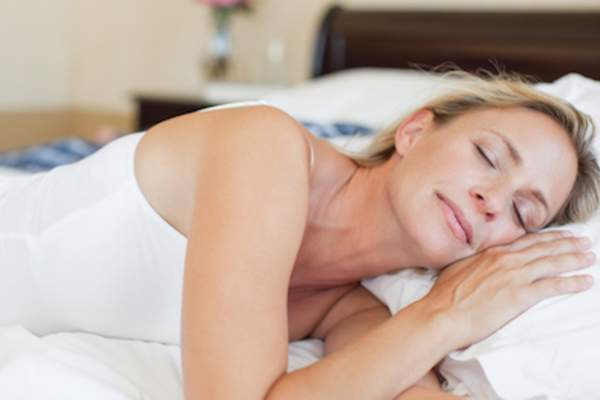 Mature woman sleeping soundly.