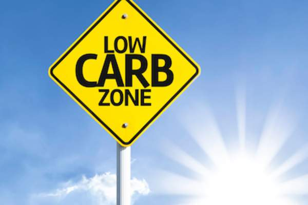 "Yellow diamond street sign reads, ""LOW CARB ZONE"""
