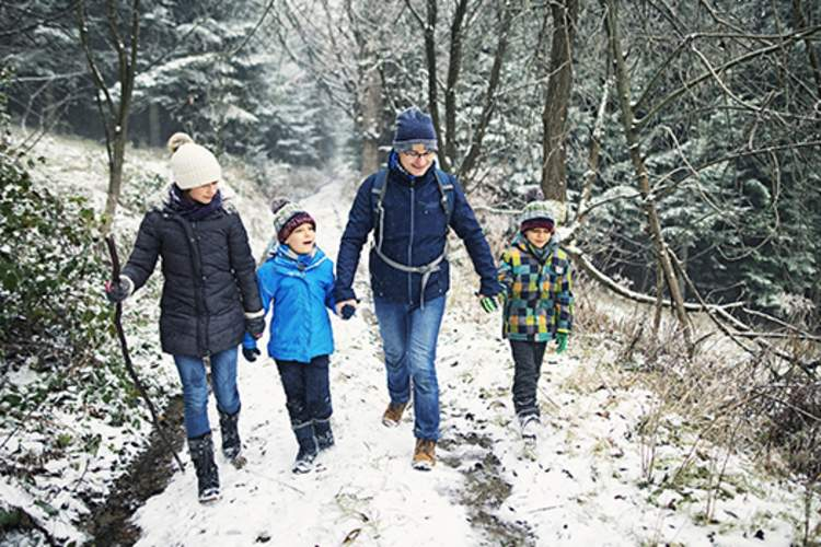 Family taking a walk together in the winter.