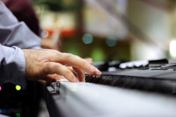 fingers lifting on piano keys