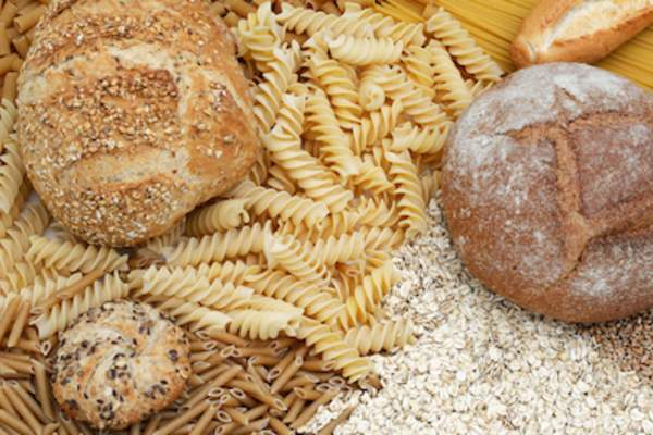 Whole wheat bread and pasta, white raw grains and oats.