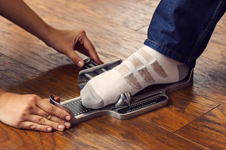 Measuring foot size with a Brannock Device