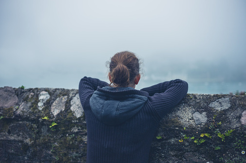 woman looking out in fog image