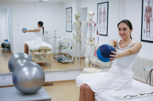 Woman training with medicine ball