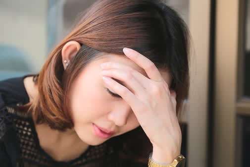 Young Asian woman with dizziness.