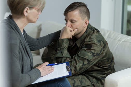 Distressed soldier talking with counselor.