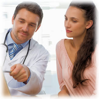 Doctor explaining to young woman patient.