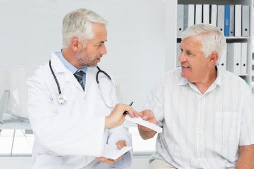 doctor giving man a prescription image