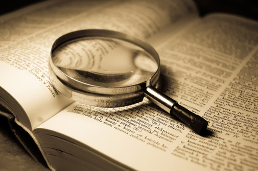 A magnifying glass shows words on a page bigger.