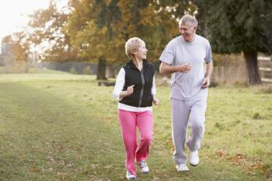 Older couple walking before dinner to help reduce their blood glucose