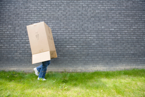 Personal walking with a box on their head.