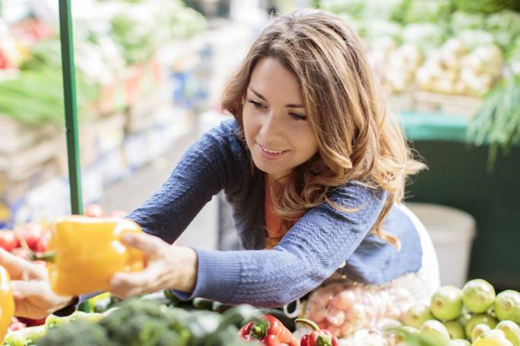 Woman shopping for vegetables.