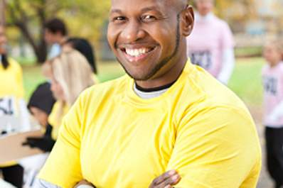 Man smiling as he stands at volunteer activity.