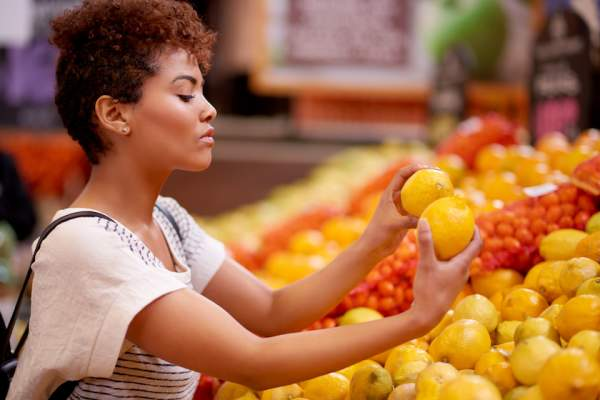 Picking out citrus fruit at the grocery.