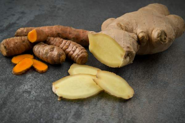 Turmeric and ginger root sliced.