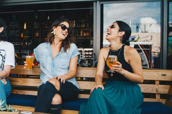 two women drinking beer together