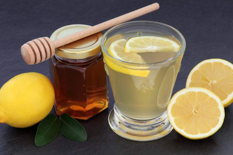 Hot water with honey and lemon.