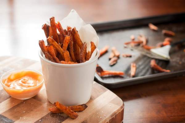 sweet potato fries in front of baking sheet