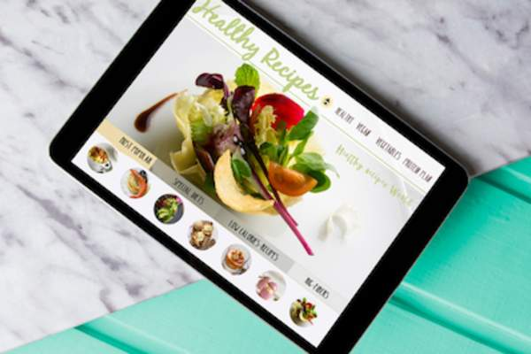 Close up of tablet web surfing healthy recipes.