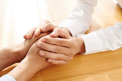 man offering woman support holding hands image