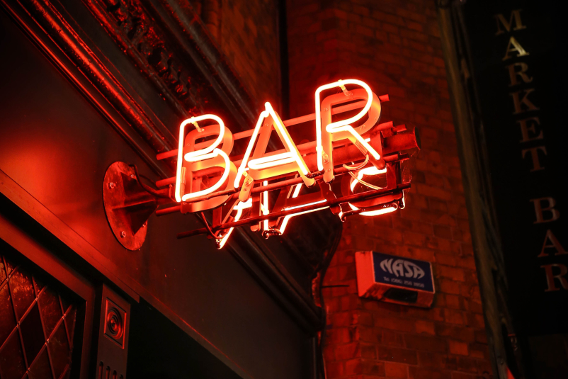 Bar sign at night.