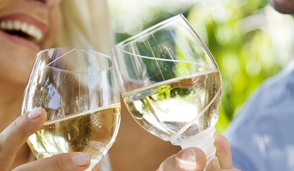 Couple drinking white wine image.