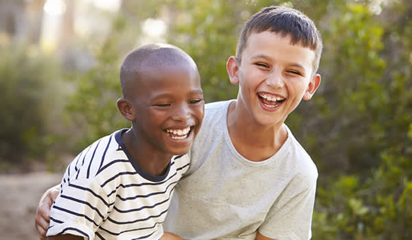 Young boys laughing in the summer.
