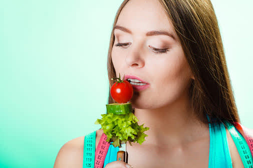 woman raw vegetables