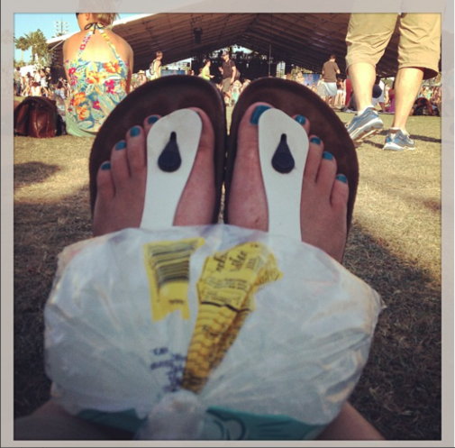 Britt's kettle corn bag of ice on her knees at a music festival