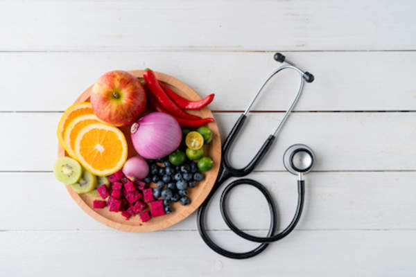 Healthy food in dish with doctor's stethoscope.