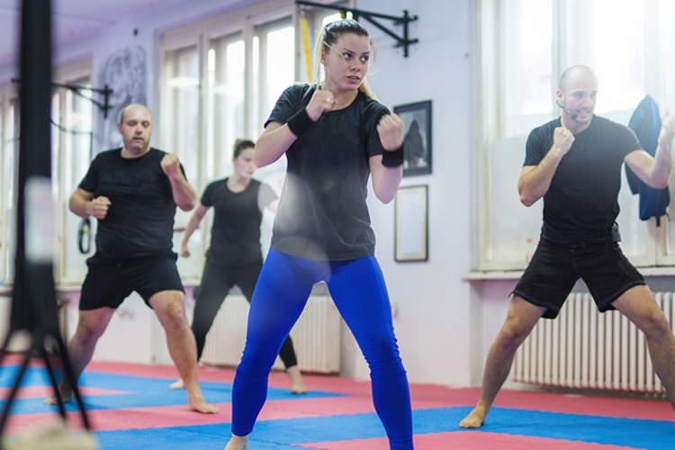 Woman takes a self-defense class.