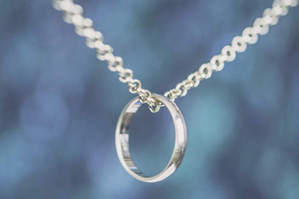 Wedding band on a chain.