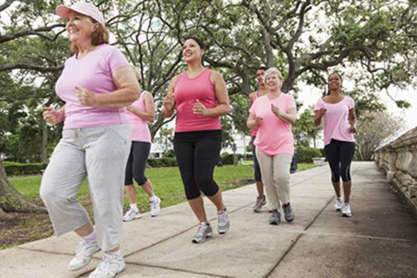 Group of breast cancer survivors jogging.