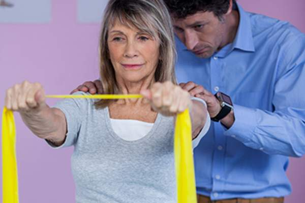 Woman working with physical therapist.