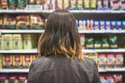 Gluten-free shopper selecting food at a grocery store.