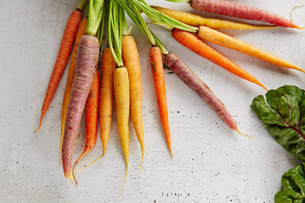 Carrots on white surface