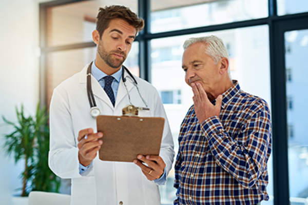 Skeptical man listening to a doctor.