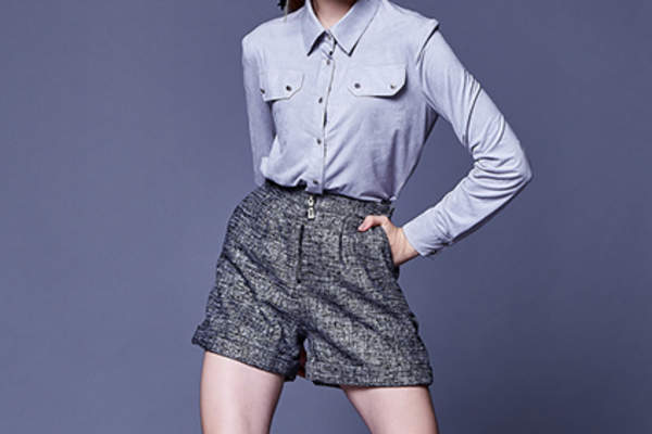 Woman wearing suit shorts.