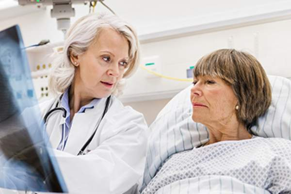 Doctor explaining diagnosis to a patient.