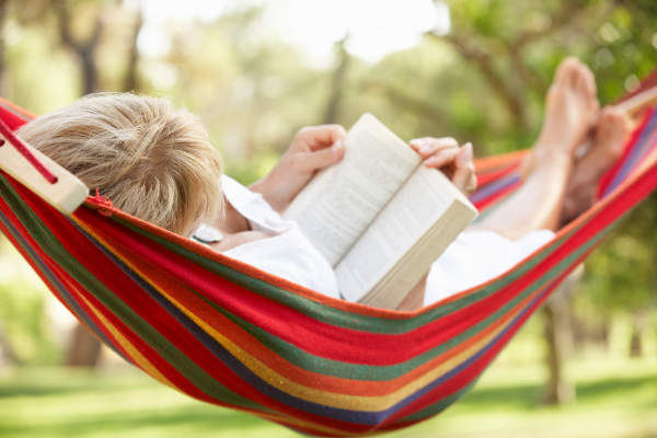 woman reading in hammock image