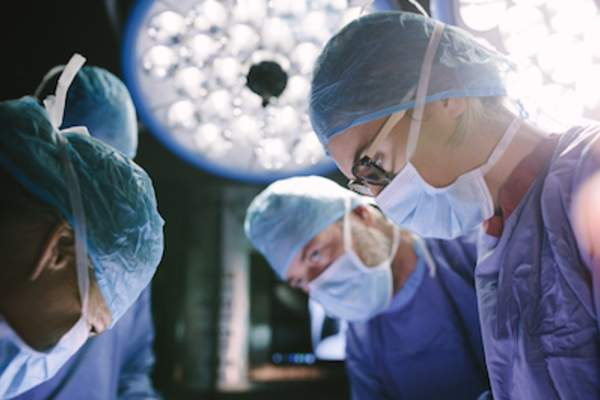 Surgeon concentrating during surgery.