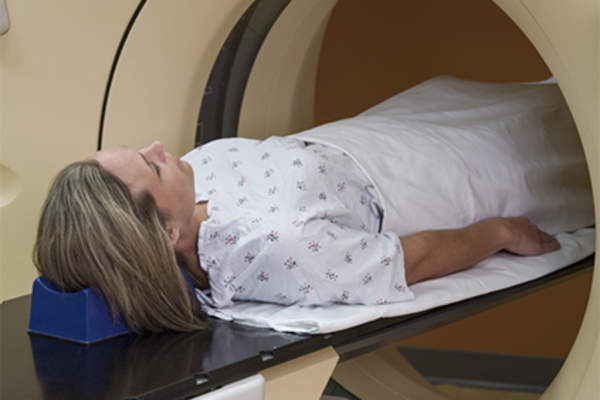 Woman having CT scan.