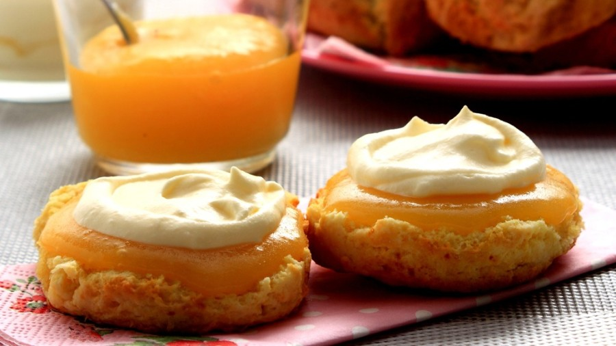 Lemon curd cookies with whipped cream.