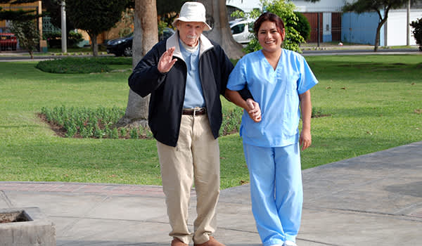John Drake and Caregiver in Lima in 2011 image