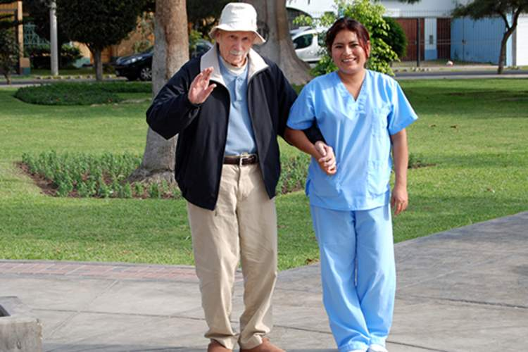 John Drake and Caregiver in Peru in 2011