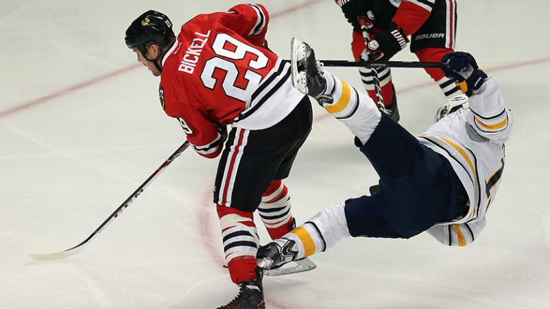 Cody Hodgson #19 of the Buffalo Sabres goes flying in the air after colliding with Bryan Bickell #29 of the Chicago Blackhawks