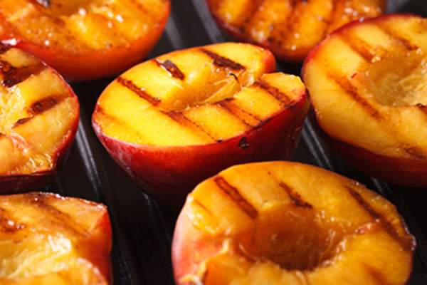 Fresh peaches on grill