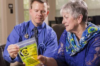 doctor and patient with chemotherapy drugs image